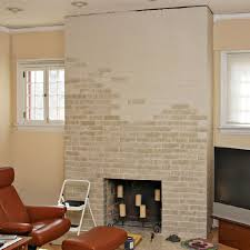 Whitewashing A Fireplace by Partially Painted Brick Fireplace Using A Base Coat Drying Then