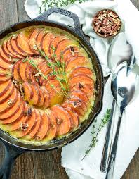 skillet scalloped sweet potatoes with maple bourbon brown butter