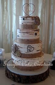 rustic birch bark wedding cake with burlap ribbon and burlap roses