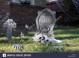 halloween graveyard with skull and bones stock photo royalty free