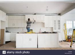 kitchen cabinet carpenter carpenter installing kitchen cabinet stock photo 84825169 alamy