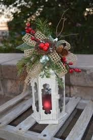 wooden and metal lantern with floral accent by tim