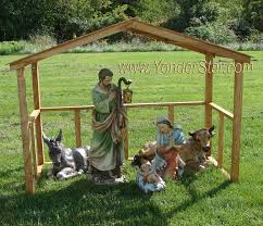 outdoor nativity set with wooden manger yonder