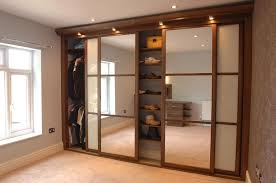 Space Saving Closet Doors Mirrored Sliding Closet Door With Shoes Rack Also Ceiling Light