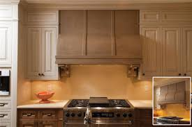 custom kitchen with granite countertops stainless steel range hood