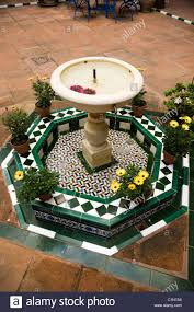 mooreish style spanish decorative courtyard water fountain in a