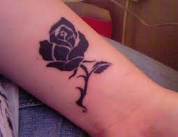 black red rose tattoo less red maybe white on the ball of my