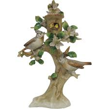german sitzendorf porcelain bird figurine in tree with baby