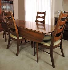 kent coffey perspecta walnut drop leaf dining table and four