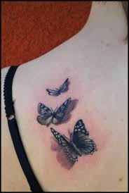 realistic butterfly tattoo by divinity tattoo