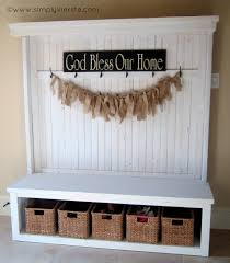 furniture white wooden foyer bench with hooks and wicker boxes