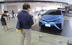toyota dealer japan toyota aims to nearly eliminate gasoline cars by 2050 chicago