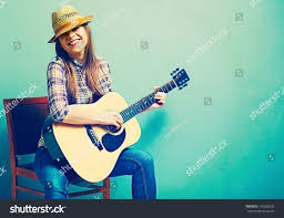 singing young model play acoustic guitar stock photo 186268535