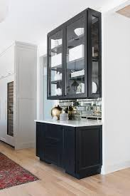 kitchen glass wall cabinets mirrored subway tiles with black glass front cabinets