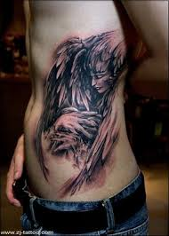 dark angel with face and wings tattoo designs tattoomagz