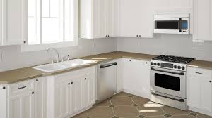 How To Stain Kitchen Cabinets by Should You Stain Or Paint Your Kitchen Cabinets For A Change In