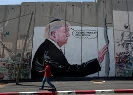 2 huge trump murals appear on west bank barrier news 1130 a mural resembling the work of elusive artist banksy depicting president donald trump wearing a jewish skullcap is seen on israel s west bank separation