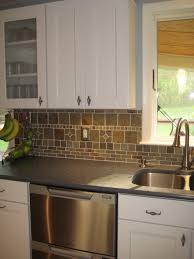 kitchen white cabinets dark countertops and slate backsplash