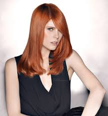 long and sleek red hair with a trendy side fringe
