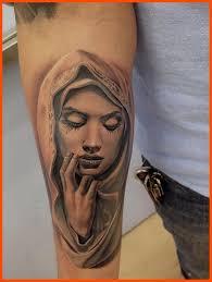 right forearm crying virgin mary tattoo