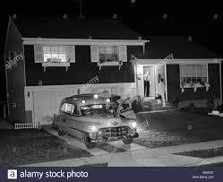 1950 S House by 1950s Ambulance At Night Parked In Suburban Home Driveway With