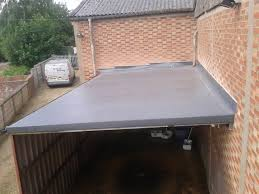 grp flat roofing synergy roofing