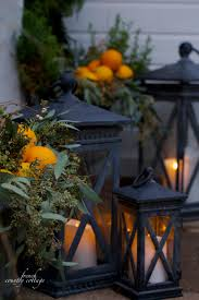 home for the holidays 4 ideas for simple front door decorating christmas front door holiday home oranges lanterns garland