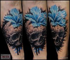 grey ink skull and flower skull on sleeve