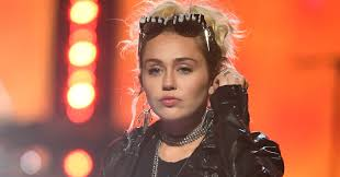 miley cyrus opens up about being pansexual and gender neutral