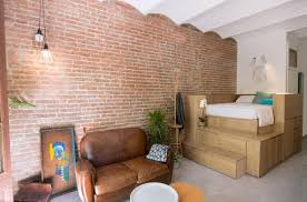 exposed brick micro flat in the heart of barcelona with exposed brick walls