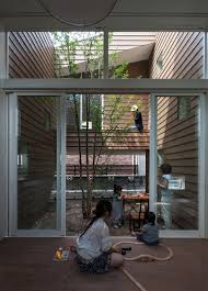a modern japanese house with a surprise garden inside design milk