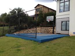 this pro dunk gold basketball system sits over a painted half court