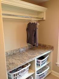 laundry room ideas like the storage baskets for different colors