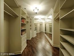 Light Walnut Laminate Flooring Traditional Closet With Hardwood Floors U0026 Built In Bookshelf In