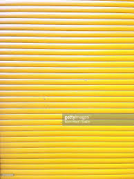 full frame shot of yellow window blinds stock photo getty images