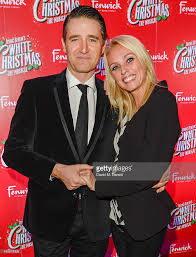 tom chambers and camilla dallerup arrive at the white christmas press picture id458876308