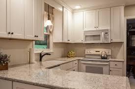 white kitchen cabinets with quartz countertops granite vs quartz countertops pros cons is quartz better