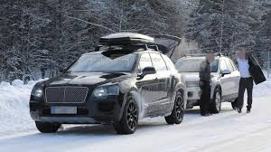bentley snow bentley bentayga sheds some serious camo in latest spy pics