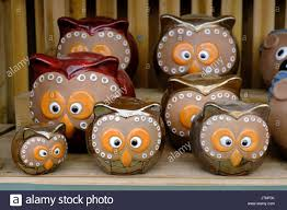 ceramic garden ornaments in the shape of cross eyed owls stock
