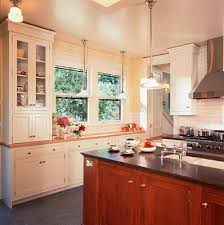 white subway tile backsplash with yellow walls white cupboards