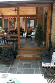 screened porches with gables and stone fireplace with slate in