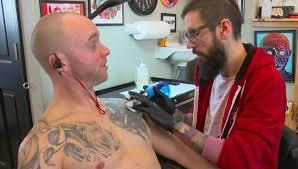 indiana legislator puts ink behind eyeball tattoo ban wish tv
