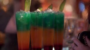 bartender preparing alcohol drinks fruit cocktails vodka colors
