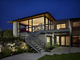 100 modern house brown wooden door and glass windows on the