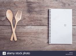Kitchen Table Close Up Close Up Wooden Spoon Fork And Lined Paper On Wooden Table Top