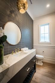 traditional powder room with hardwood floors u0026 wainscoting in