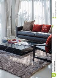Pillows For Brown Sofa by Modern Living Room With Brown Sofa And Red Pillows Stock Photo