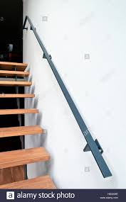 K He Modern Hardwood Stairs And Ramp In Modern Renovated Living Room Stock