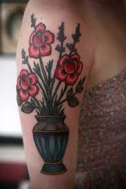 alice carrier tattoo vase of flowers on arm tattoomagz