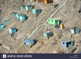 houses built on slopes brightly painted wooden houses built on sandy slopes in the dry
